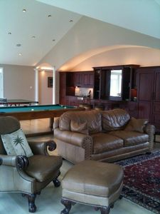Great room w/bar, pool, ping pong, leather chairs, lake views, 3 decks.