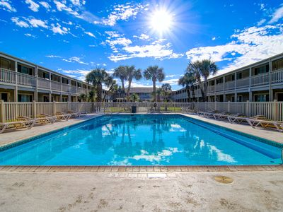 Photo for Fully remodeled condos! Large pool! Only a block to the beach!