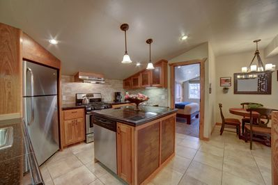 A full size kitchen that is easy to cook in or bring home food to.