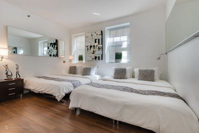 Bedroom with 1 king and 1 twin bed or 3 twins