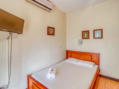 Photo for Comfortable hotel room w/great location, A/C, and shared outdoor pool!