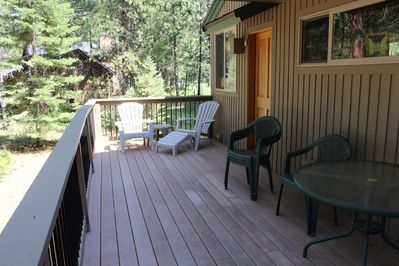 Front deck with secondary entrance.