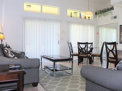 Photo for Nice 2 bed 2 bath townhome with private screened porch and heated community pool & spa in gated community Mango Key near Disney, Orlando, Florida