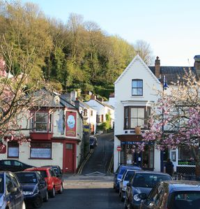 Bottom of Village Lane. Junction with Mumbles Road, from the sea. Cafe right