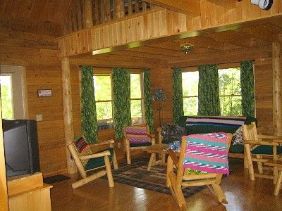 Birch Overlook Cabin - Open living area overlooking the front porch and pond.