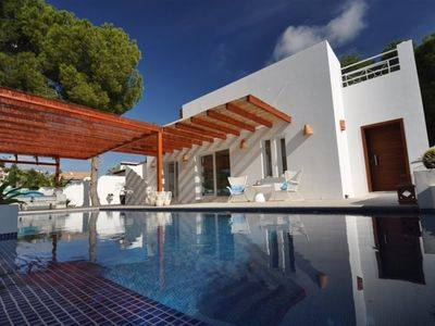 Photo for New Ibiza-style villa in Moraira El Portet, sea view, roof terrace of 150m2