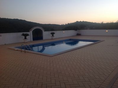 View of pool at sunset.