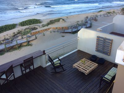 Photo for Ocean Front PH w/ beautiful deck 3 BDR- 3BR - At Jobos Beach & near Shacks Beach