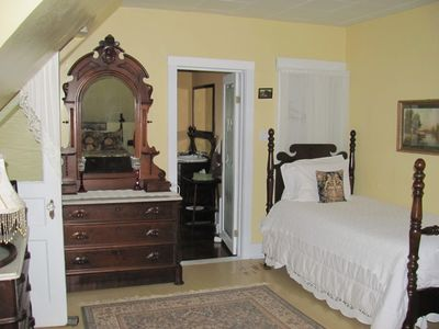 single bed beside the entrance to the bathroom