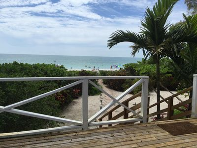 View of beach from the deck and stairs leading from deck to beach.