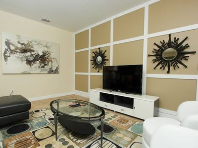 Photo for 2 large flat screen TVs along with flat screens in all of the bedrooms