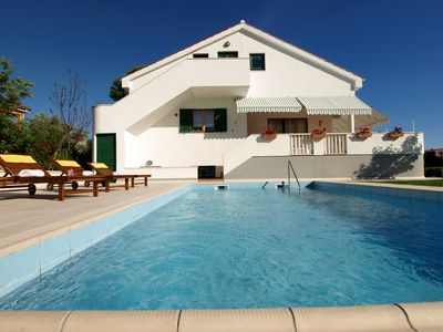 Photo for This 4-bedroom villa for up to 7 guests is located in Zadar and has a private swimming pool, air-con