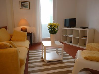 Photo for Charming village house with terrace in the center of the village