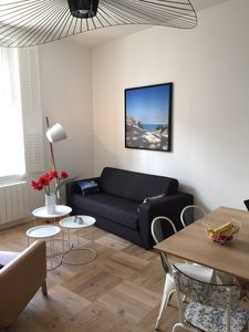 Photo for Comfortable and modern just steps from the beach in the heart of town.