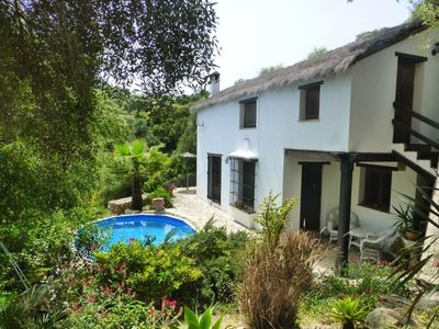 Photo for Rustic, charming thatched cottage with private pool inside natural park
