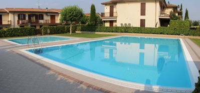 Photo for Apartment Oleandro - Large studio in a residence with swimming pool in LAZISE