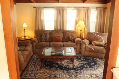 Living room with comfortable couch, love seat and lazy boy