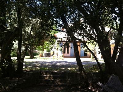 Photo for Beautiful villa equipped with terrace and barbecue overlooking a garden with olive trees