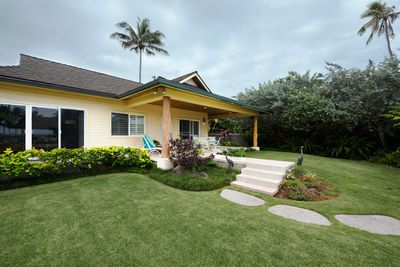 Front of the house with the lanai. View looking from the driveway to the house.