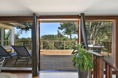 French doors open out to deck with beautiful views of the Sonoma Mountains