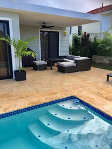 Covered Terrace with, ceiling fans, patio couches and table