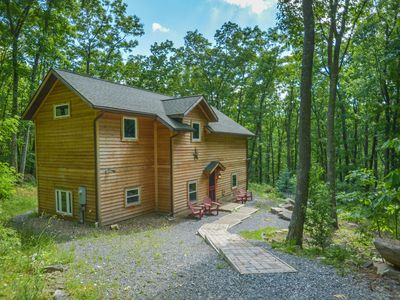 Photo for Mountain home in wooded setting with fire pit & convenient location!