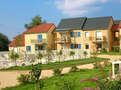 Photo for Nice holiday park with swimming pool in the middle of the Dordogne