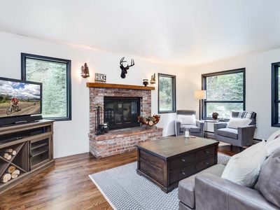 Photo for One of a kind mountain cabin tucked away in the woods! Perfect romantic getaway!