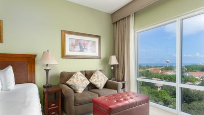 Living Room - Kick back on a twin-size sleeper sofa with views overlooking Choctawhatchee Bay.