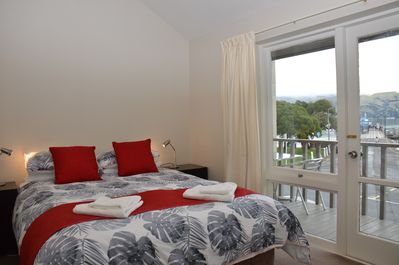 Master bedroom with queen bed, walk onto the deck and enjoy the stunning views