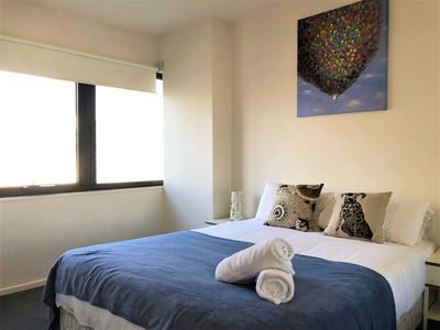 Photo for COZY 1BR Apartment + WiFi/Gym/Pool at the Heart of Melbourne