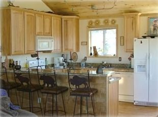 Full kitchen, w/dishwasher, microwave, stove, refrigerator & trash compatctor