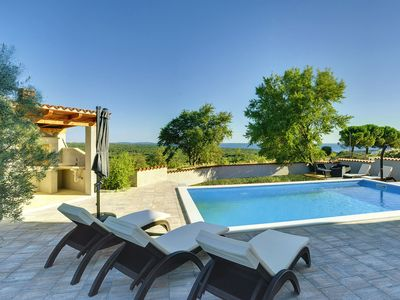 Photo for This 2-bedroom villa for up to 4 guests is located in Pula and has a private swimming pool, air-cond