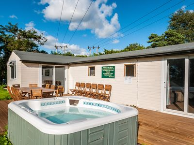 Photo for Luxury cabin in great location, hot tub, sleeps 18