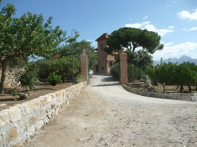 entrance to the villa along a romantic dirty road among Sicilian citrus trees