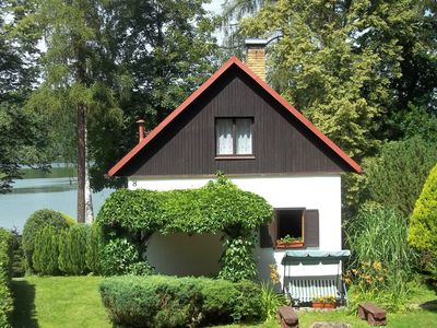 Photo for Nice holiday home with fireplace and terrace on the lake, ideal for anglers