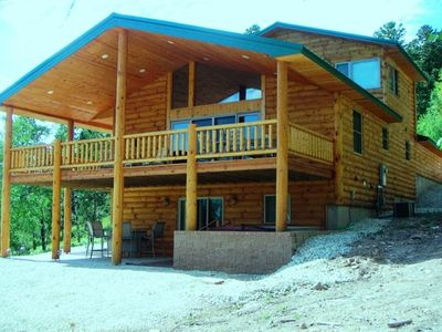 Terry Peak Cabin Features Wrap-around Deck, Walk-out Patio & Hot Tub.