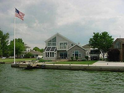 Photo for Large Luxury Lake Front Home on Grand Lake, with boat docks and Tiki Bar!
