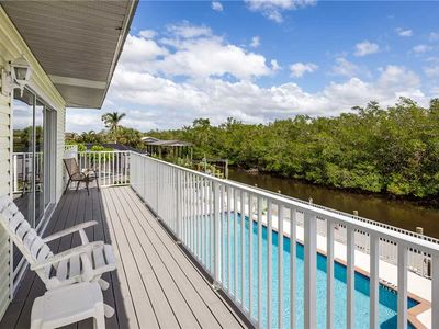Photo for Tropical Shores 4,  Upper Floor 2 Bedrooms, Heated Pool, Sleeps 6