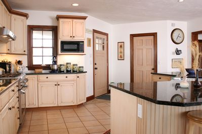 Raised kitchen with panoramic views of the beach and Barnstable Harbor.