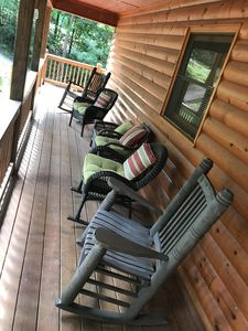 Sit on the front porch in oversized rocking chairs and watch the deer walk by