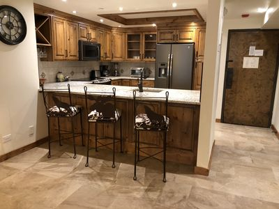 Kitchen area with bar stools