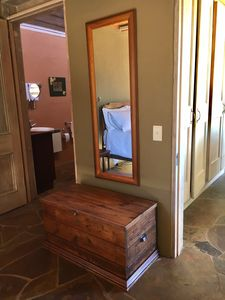 Bedroom chest and entry to bath