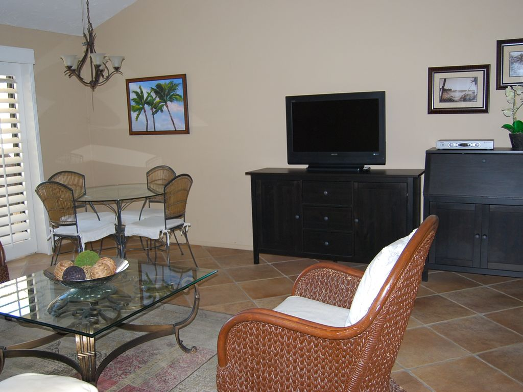 Dining table and TV. TOMMY BAHAMA STYLE OASIS    VRBO