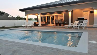 Large pool, spacious pool deck and porch