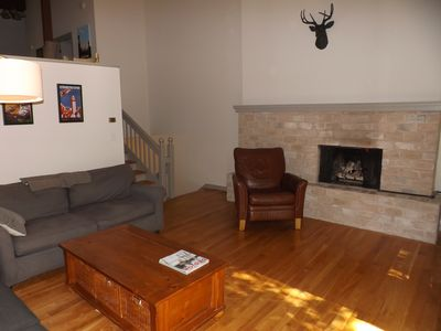Split level living area with gas fireplace