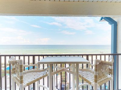 Photo for Stylish oceanfront escape with shared pool, sweeping beach views, and more!