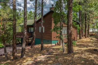 Nestled in tall trees and greenery, you'll love the privacy and location.