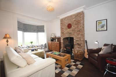 Spacious and comfortable lounge with sweeping views over cricket/rugby ground