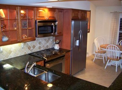 EAT-IN KITCHEN AND BAR (custom cabinetry and appliances)